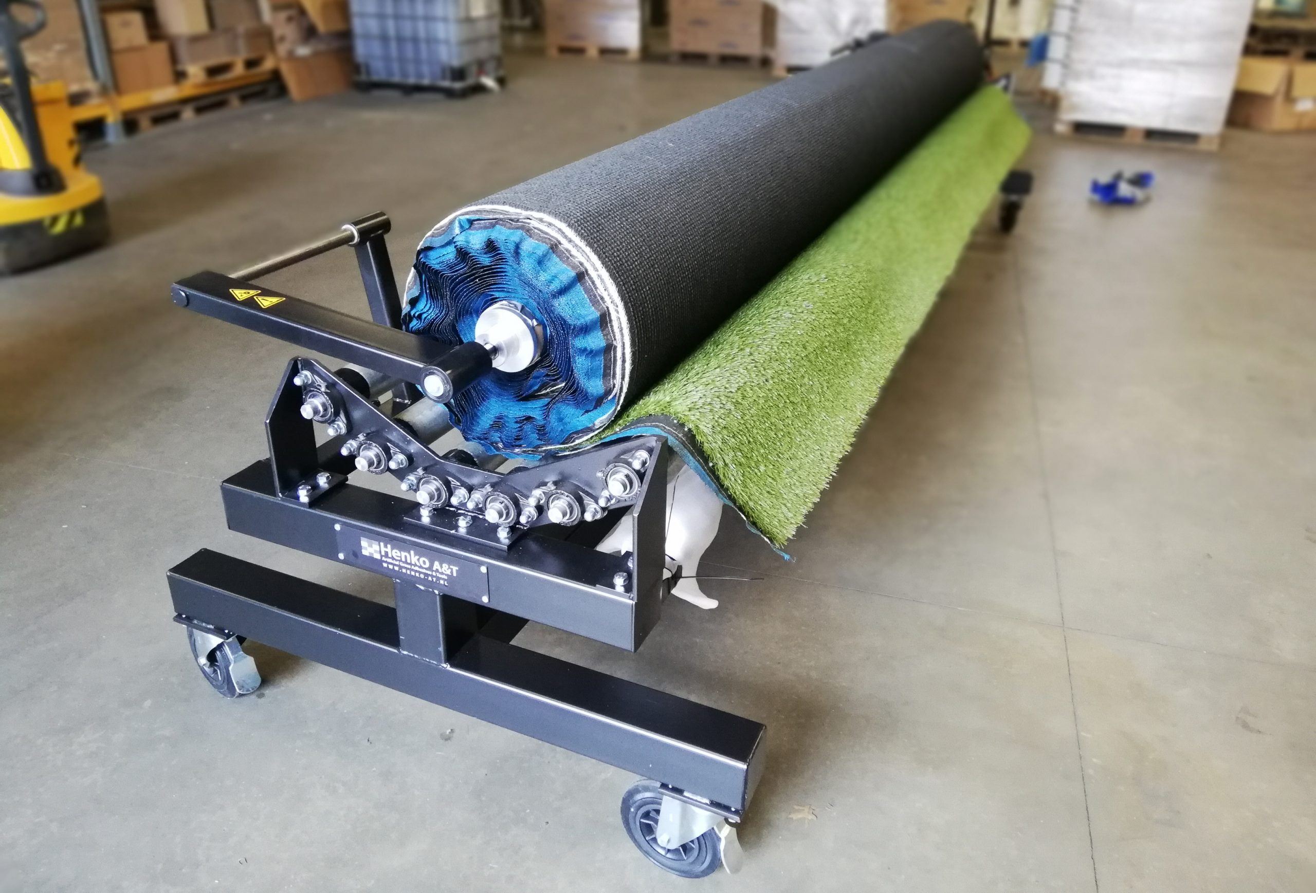 unrolling rolling artificial grass
